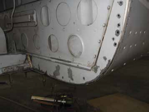 Aft bulkhead with Uvalde wheel well cover and flange removed. Shows where original bulkhead was trimmed to match outer skin of fuselage.