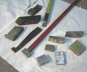 A handful of a bucking bar collection. The ones to the right of the long red handle are tungsten. Some bars are cut and polished for one specific application.