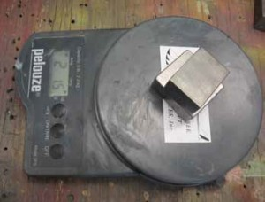 The 2 tungsten bars on the scale for weigh in.