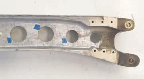 The damaged spar with the grid markings created by the owner's mechanic that found the corrosion damage. Pictures and details of the damage sent to Cessna engineering proved the carry-thru spar was not fit for airworthy service.