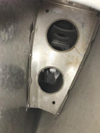 A bent and cracked nose rib inside a Cessna 210 horizontal.